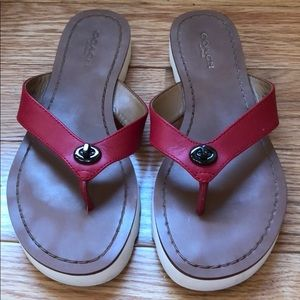 Coach flip flops with toggle